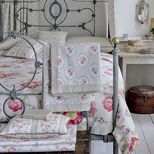 Use floral fabric for a romantic bedroom scheme