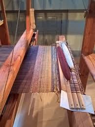 How is woven fabric made?