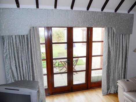 Upholstered pelmet was made to complement the beautiful curtains